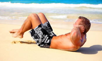 beach body doing crunches six pack abs